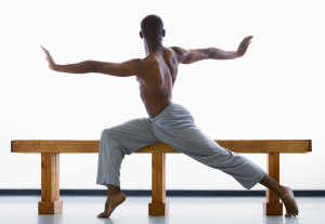 Ballet Dancer on Bench with Arms Outstretched